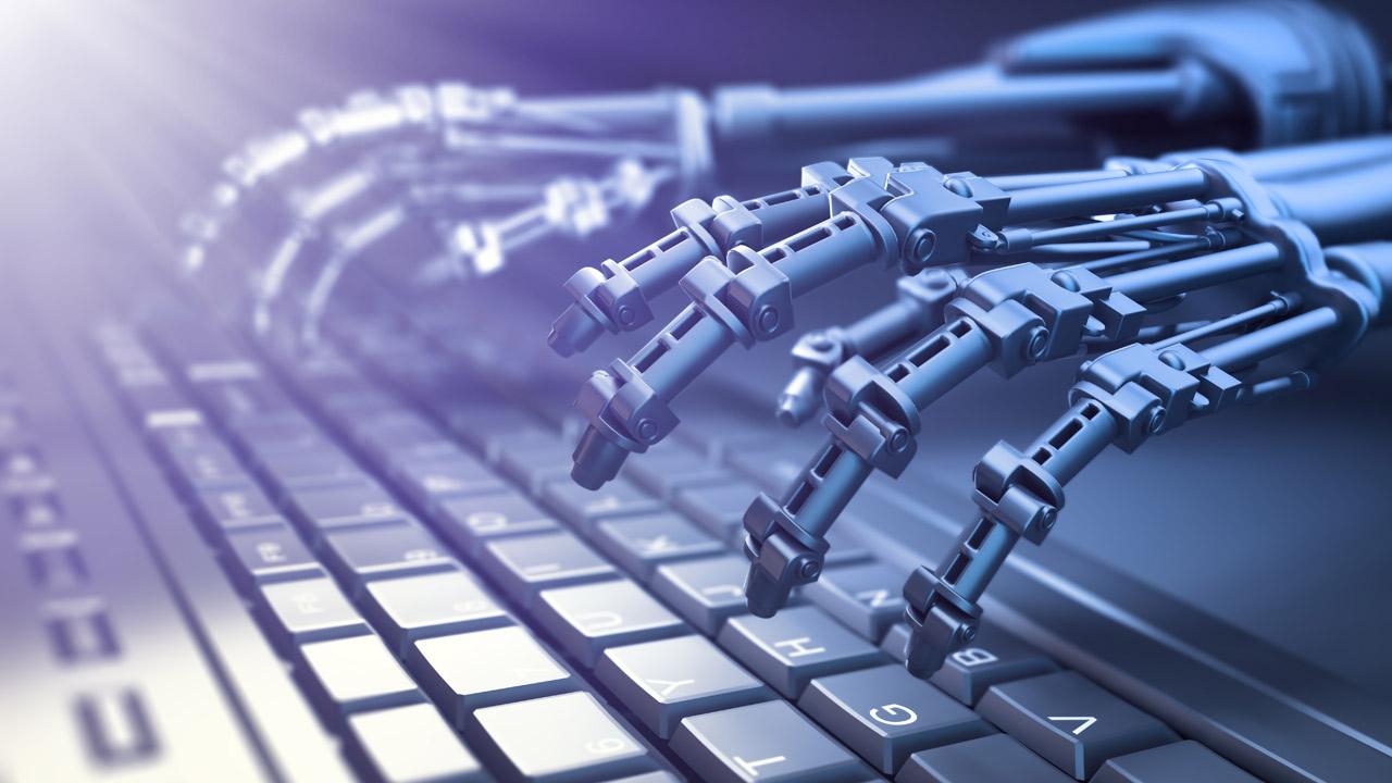 Roboterhand auf Tastatur - Shutterstock